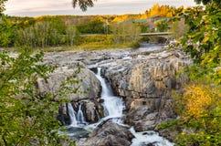 Cachoeira no por do sol Fotografia de Stock