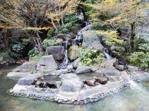 Cachoeira pisada pequena no jardim oriental Imagem de Stock Royalty Free