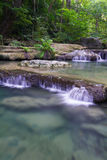 Cachoeira profunda da floresta (cachoeira de Erawan) Imagens de Stock Royalty Free