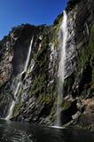 Cachoeiras altas em Fiordland NZ Fotografia de Stock