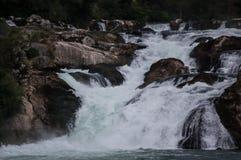 Cachoeiras com rochas Imagens de Stock