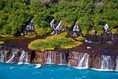 Cachoeiras de Hraunfossar em Islândia Fotografia de Stock Royalty Free