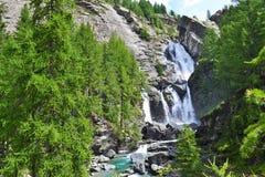 Cachoeiras de Lillaz em Cogne, parque nacional do paraíso grande, o Vale de Aosta, Itália fotografia de stock royalty free