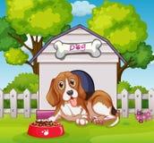 Cachorrinho que vive na casa de cachorro ilustração stock