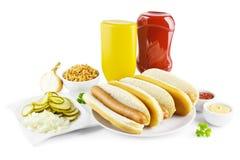 Cachorros quentes e ingredientes Fotografia de Stock
