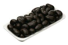 Cachou in chocoladeglans stock foto's