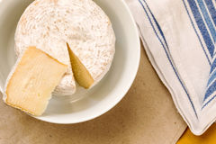 Caciotta slice over whole mature cheese Stock Photography