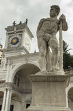 Caco statue and clock tower Stock Image