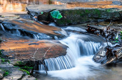 Cacscading Water Along Carreck Creek. Cool water cascading down the Carreck Creek at sunrise in South Carolina Stock Image