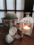 Cactus and candle. A mellow picture of cactus, candle and watch Stock Photo