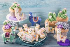 Cactus cupcakes and llama cookies. For children party royalty free stock images