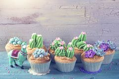 Cactus cupcakes. Cactus and llama sweets for children party royalty free stock images