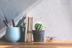 cactus flower with notebook on office wood table modern interior Stock Photos