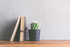 cactus flower with notebook on wood table modern interior backgr Royalty Free Stock Image