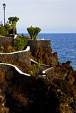 Cactus street lamp chain hill coastline lanzarote. In spain musk pond beach  water   and summer Stock Photos