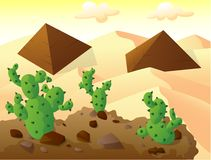 Cactus on top of a hill, with two pyramids in sand desert Royalty Free Stock Photos