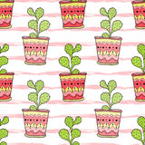 Cactuses seamless pattern. Colorful cartoon flowers in pots. Vector background for textile design.  royalty free illustration