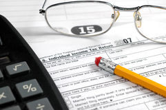 Caculating taxes Stock Image