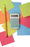 Caculator, adhesive notes and pencil isolated on white backgroun. Calculator, adhesive notes and pencil isolated on white background with clipping path. Above Royalty Free Stock Photos