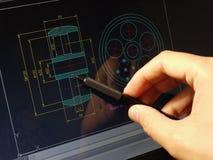 Cad blueprint. Designer working on a cad blueprint stock images