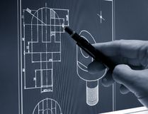 Cad design. Designer working on a cad blueprint monochrome image royalty free stock photography