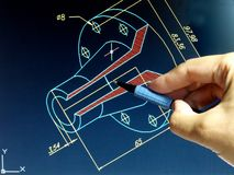 Cad design. Engineer working on cad blue print Stock Images