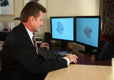 CAD Designer. Mechanical cad designer working on a mechanical assembly royalty free stock images