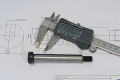 CAD Quality Control 1. Quality control process, checking part against CAD drawing royalty free stock photo