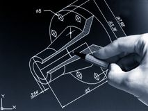 Cad work. Engineer working on cad blue print monochrome image stock photo