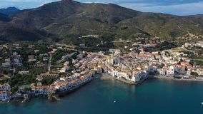 Cadaques amazing spanish town by the sea. Punta de sa Costa. Video footage. Aerial drone camera moves away from the. Beach at sea. view to mountains landscape stock video