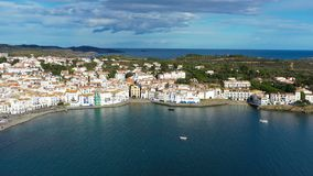 Cadaques beautiful spanish town by the sea. Punta de sa Costa. Video footage. Aerial drone camera moves away from the. Beach at sea. view to mountains landscape stock video