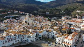 Cadaques beautiful spanish town by the sea. Punta de sa Costa. Video footage. Aerial drone camera moves away from the. Beach at sea. From close up to panoramic stock video