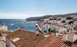 Cadaques. Ship in the mediterranean sea in Cadaques located in the Spanish province of Girona in Catalonia. We see the  houses in the of the village in a sunny Royalty Free Stock Image
