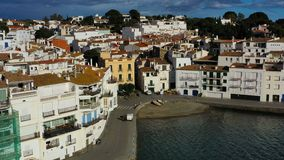 Cadaques Spain. Aerial drone video footage of the camera approaches the city. sunny daylight. Cadaques Spain white city by the sea. Aerial drone video footage stock footage