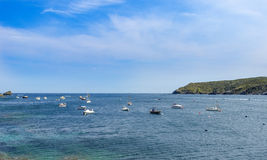 Blue sea and boats Stock Image