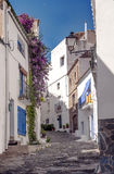 Cadaques street. Located in the Spanish province of Girona in Catalonia. We see balcony with flowers. It is an image vertically on a sunny day Royalty Free Stock Photos