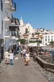Cadaques street. Located in the Spanish province of Girona in Catalonia. We see people walking in the street near the see in a sunny day. It is an image Royalty Free Stock Images