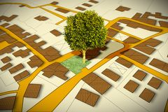 Cadastral map with a tree on a green area - concept image royalty free stock photos