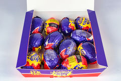 Cadbury`s Creme Egg. CHESTER, UNITED KINGDOM - March 19 2017: Cadbury`s Creme Egg box. Open box showing 12 Creme Eggs. A popular chocolate treat for the Easter Royalty Free Stock Image
