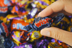 Cadbury Wispa candy in woman hand Royalty Free Stock Images