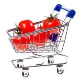 Caddie avec des tomates-cerises Images stock