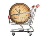 Caddie avec l'horloge Image stock