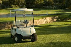 Caddie car and green Stock Images