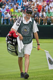 Caddie for Miguel Angel Jimenez. On the 18th green Royalty Free Stock Photo