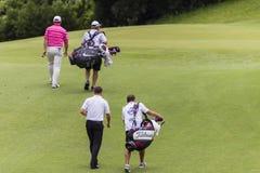 Caddies van de Spelers van het golf de Pro Stock Afbeeldingen