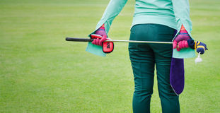 Caddy. Girl caddy hold the golf club from behide Royalty Free Stock Photo