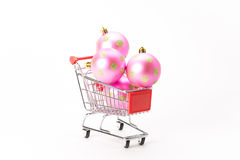 Caddy for shopping with christmas ball Royalty Free Stock Photography