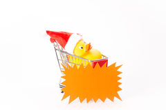 Caddy for shopping with christmas duck Royalty Free Stock Images