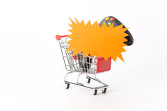 Caddy for shopping with game pad Royalty Free Stock Images