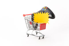 Caddy for shopping with game pad Royalty Free Stock Photography